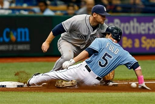 Tampa Bay Rays' Sam Fuld (5) slides in safely with a triple as San Diego Padres third baseman Chase Headley waits for the throw during the fifth inning of an interleague baseball game on Sunday, May 12, 2013, in St. Petersburg, Fla.