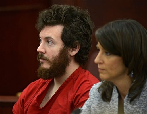 In this March 12, 2013 file photo, James Holmes, left, and defense attorney Tamara Brady appear in district court in Centennial, Colo. for his arraignment. (AP Photo/The Denver Post, RJ Sangosti, Pool, File)