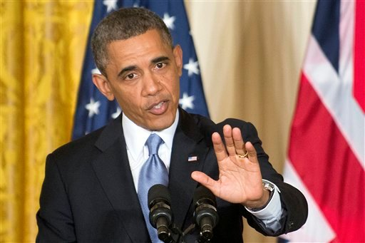 resident Barack Obama gestures during a joint news conference with British Prime Minister David Cameron, Monday, May 13, 2013, in the East Room of the White House in Washington.