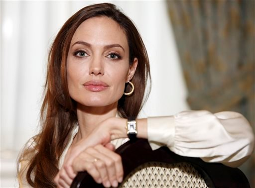 "In this Saturday, Dec. 3, 2011 file photo, actress Angelina Jolie poses for a portrait to promote her directorial debut of the film ""In the Land of Blood and Honey"" in New York."