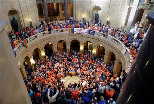 Thousands filled the Minnesota State Capitol as they waited for word that the Senate had passed the gay marriage bill Monday, May 13, 2013 in St. Paul, Minn. The bill now goes to the governor who is expected to sign it. (AP Photo/Jim Mone)