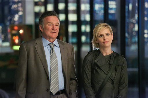 "This publicity image released by CBS shows Robin Williams, left, and Sarah Michelle Gellar in a scene from the pilot episode of ""The Crazy Ones,"" a new CBS comedy premiering in the fall of 2013."