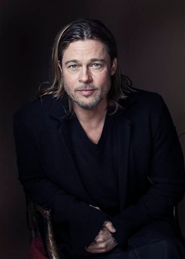 "This Nov. 26, 2012 file photo shows actor Brad Pitt posing for a portrait to promote his film, ""Killing Them Softly,"" in New York."