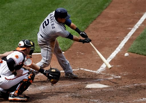 San Diego Padres' Everth Cabrera, right, singles in the sixth inning of a baseball game against the Baltimore Orioles in Baltimore, Wednesday, May 15, 2013. San Diego won 8-4. (AP Photo/Patrick Semansky)
