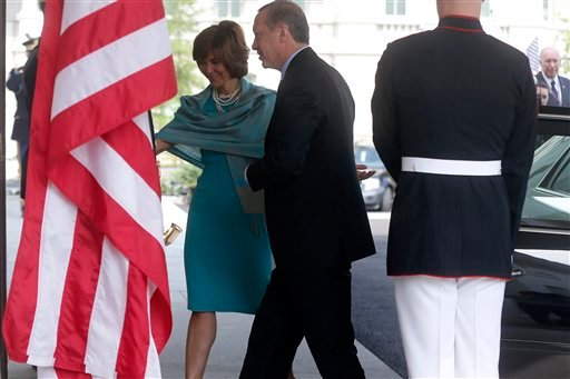 Turkish Prime Minister Recep Tayyip Erdogan is greeted by U.S. Chief of Protocol Capricia Marshall as he arrives to meet with President Barack Obama at the White House in Washington, Thursday, May 16, 2013. (AP Photo/Charles Dharapak)