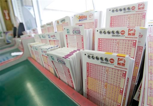 Powerball tickets, right, along with other lotto tickets are seen Thursday, May 16, 2013, at a convenience store in Orlando, Fla.