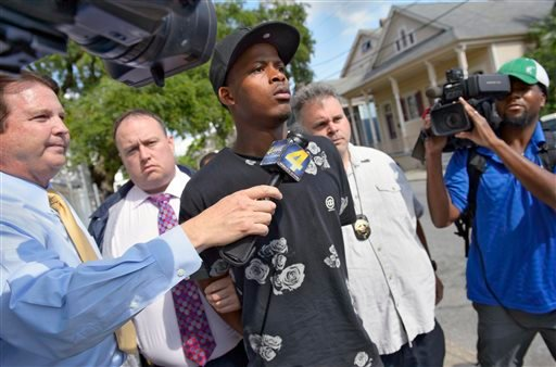 Shawn Scott, 24, a suspect in the Mother's Day parade shooting is led out of the New Orleans 5th District Police Station, Thursday, May 16, 2013 in New Orleans.