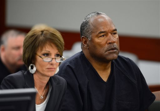 Defense attorney Patricia Palm, left, and O.J. Simpson appear at an evidentiary hearing in Clark County District Court on May 17, 2013 in Las Vegas.