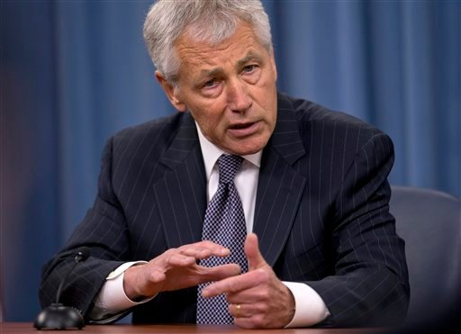 "Defense Secretary Chuck Hagel gestures as he speaks during a news conference at the Pentagon, Friday, May 17, 2013, to discuss sexual assaults in the military and the promotion of Lt. Gen. Curtis ""Mike"" Scaparrotti to command U.S. troops in South Korea."