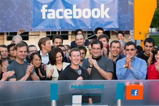 In this May 18, 2012, file photo, provided by Facebook, Facebook founder, Chairman and CEO Mark Zuckerberg, center, rings the opening bell of the Nasdaq stock market, from Facebook headquarters in Menlo Park, Calif.