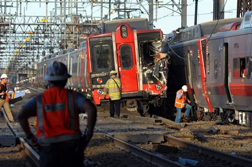 Emergency personnel work at the scene where two Metro North commuter trains collided, Friday, May 17, 2013 near Fairfield, Conn.