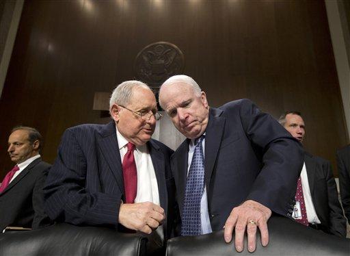In this April 9, 2013, file photo Sen. Carl Levin, D-Mich., left, talks with Sen. John McCain, R-Ariz., on Capitol Hill in Washington.