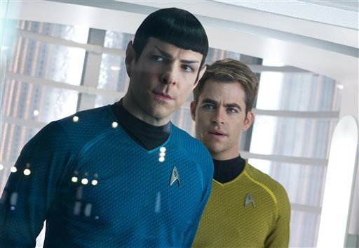 """This undated publicity film image released by Paramount Pictures shows, Zachary Quinto, left, as Spock and Chris Pine as Kirk in a scene in the movie, """"Star Trek Into Darkness,"""" from Paramount Pictures and Skydance Productions."""