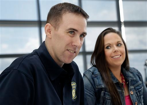 MBTA Police Officer Richard Donahue smiles with his wife, Kim, during an interview at Spaulding Rehabilitation Hospital in Boston's Charlestown section, Sunday, May 19, 2013.