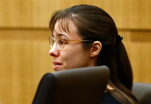 """Jodi Arias cries as Steven Alexander, brother of murder victim Travis Alexander, makes his """"victim impact statement"""" to the jury in this Thursday, May 16, 2013 photo."""