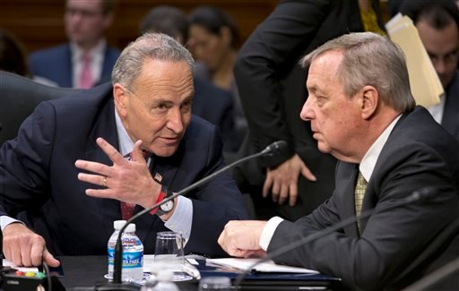 Senate Judiciary Committee members Sen. Chuck Schumer, D-N.Y., left, and Sen. Richard Durbin, D-Ill. confer on Capitol Hill in Washington, Monday, May 20, 2013. (AP Photo/J. Scott Applewhite)