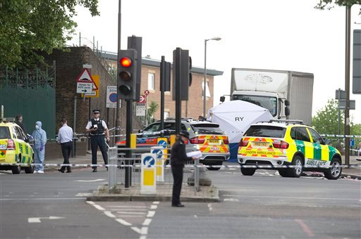A tent is erected near the scene of an attack in Woolwich southeast London Wednesday, May, 22, 2013. (AP Photo/Alastair Grant)