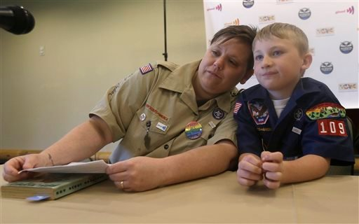 Former Boys Scout leader Jennifer Tyrrell, left, rests her head on her son and current Boy Scout Cruz Burns, 8, before an news conference at the Equal Scouting Summit. (AP Photo/LM Otero)