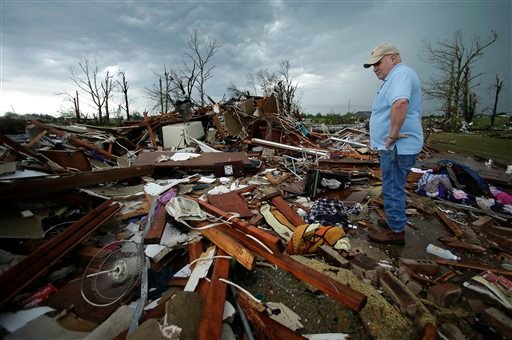Monty Montgomery surveys the scene as he prepares to clean up a friend's tornado-ravaged home Thursday, May 23, 2013, in Moore, Okla. (AP Photo/Charlie Riedel)