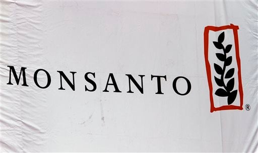 This Aug. 31, 2011 file photo shows the Monsanto corporate logo at their exhibit booth during the Farm Progress Show, in Decatur, Ill.