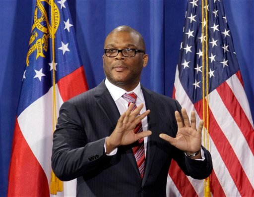 In this Friday, March 16, 2012 file photo, filmmaker and actor Tyler Perry takes the stage to introduce President Barack Obama during a fundraiser at Perry's film studio, in Atlanta.