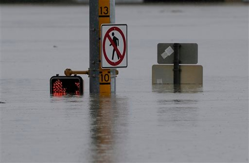 A flood gage shows waters just under 10 feet at an intersection, Saturday, May 25, 2013, in San Antonio. (AP Photo/Eric Gay)