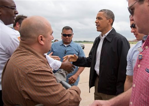 President Barack Obama greets people on the tarmac as he arrives Sunday, May 26, 2013, at Tinker Air Force Base in Midwest City, Okla., en route to the Moore, Okla., to see the response to the severe tornadoes and weather that devastated the area.