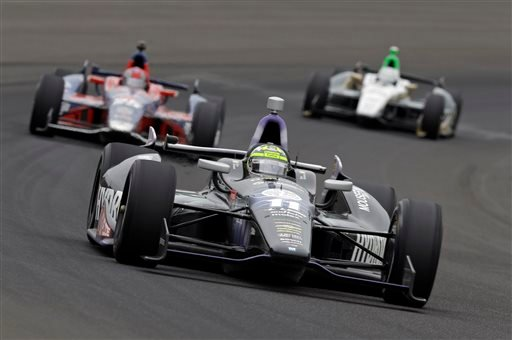 Tony Kanaan, of Brazil, drives through the first turn during the Indianapolis 500 auto race at the Indianapolis Motor Speedway in Indianapolis Sunday, May 26, 2013. (AP Photo/Tom Strattman)