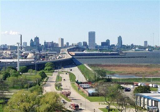 This May 23, 2013, photo shows a view of downtown Milwaukee with Lake Michigan and its shoreline to the right.