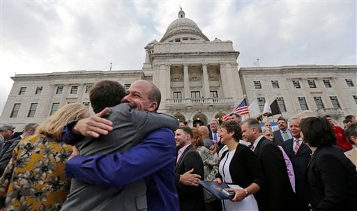 In this May 2, 2013, file photo two men embrace after a gay marriage was signed into law outside the State House in Providence, R.I.