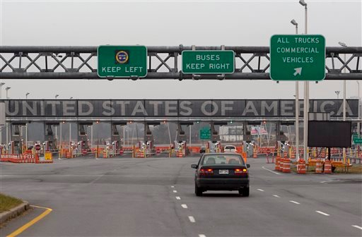 In this Wednesday, Dec. 7, 2011 file photo, a car approaches the United States and Canada border crossing in Lacolle, Quebec, south of Montreal.