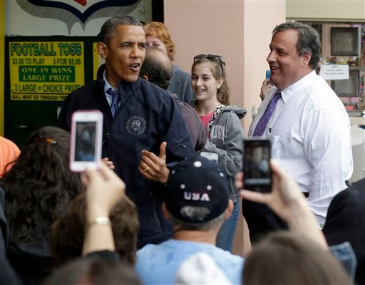 President Barack Obama, accompanied by New Jersey Gov. Chris Christie, stop to play the 'Touchdown Fever' arcade game on the boardwalk during their visit to Point Pleasant, NJ., Tuesday, May 28, 2013. (AP)