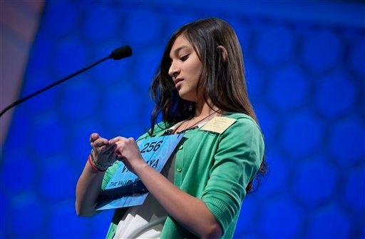 "Vismaya Kharkar, 14, of Bountiful, Utah works on the word ""stultiloquence"" before spelling it correctly during the semifinal round of the National Spelling Bee, Thursday, May 30, 2013, in Oxon Hill, Md. (AP Photo/Evan Vucci)"