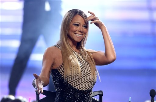 """FILE - This May 16, 2013 file photo shows Mariah Carey at the """"American Idol"""" finale at the Nokia Theatre at L.A. Live in Los Angeles. (AP)"""