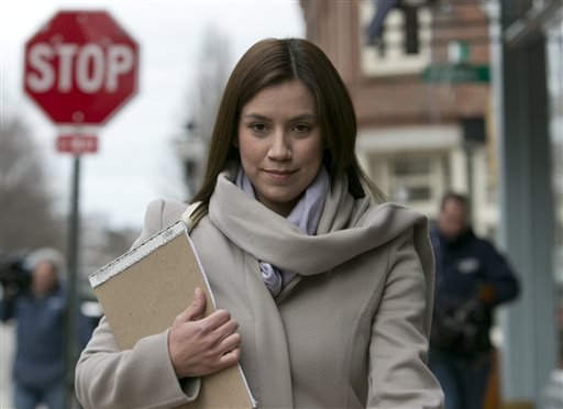 In this March 13, 2013 file photo, Alexis Wright, 30, leaves the Cumberland County Courthouse in Portland, Maine.