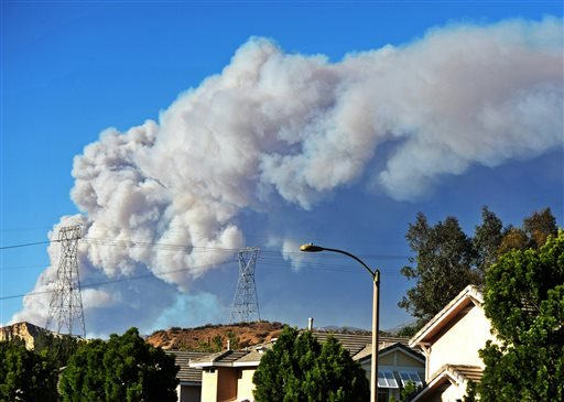Smoke from the Powerhouse Fire is visible from the Saugus neighborhood of Santa Clarita, Calif., Thursday, May 30, 2013.