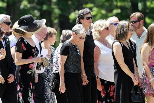 Family and friends arrive for a memorial service for Nancy Lanza on Saturday June 1, 2013 in Kingston, N.H.