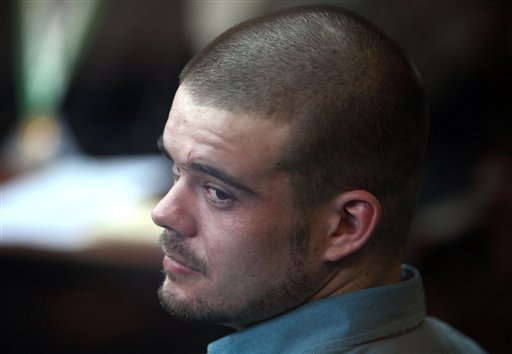 In this Jan. 11, 2012 file photo, Joran van der Sloot looks back from his seat after entering the courtroom for the continuation of his murder trial at San Pedro prison in Lima, Peru.
