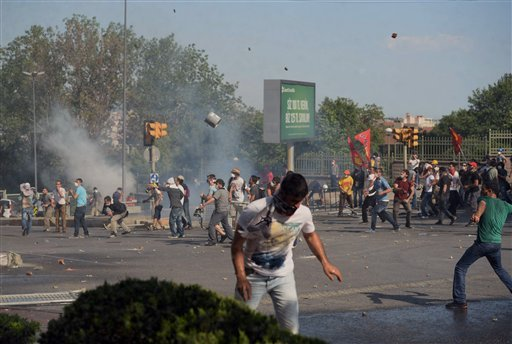 Turkish protesters clash with riot police at the city's main Taksim Square in Istanbul, Turkey, Saturday, June 1, 2013.