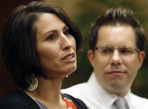 Yanira Maldonado, 42, accompanied by her husband, Gary, speaks to the media after arriving home, Friday, May 31, 2013 in Goodyear, Ariz.