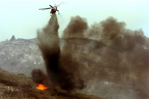 A helicopter puts out a hot spot on the Powerhouse fire at Elizabeth Lake on Sunday, June 2, 2013.