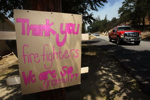 A sign shows gratitude to the firefighters who saved homes from the Powerstation fire in Lake Hughes on Sunday, June 2, 2013.