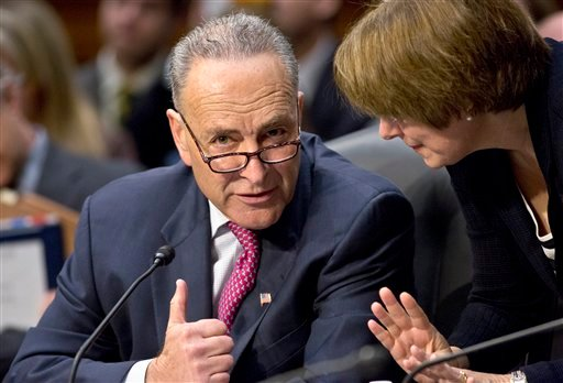 In this May 9, 2013, file photo Sen. Chuck Schumer, D-N.Y., left, confers with Sen. Amy Klobuchar, D-Minn., as the Senate Judiciary Committee meets on immigration reform on Capitol Hill in Washington.