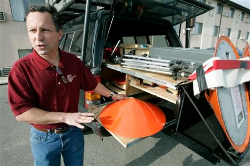 In this May 26, 2006, file photo Tornado chaser Tim Samaras shows the probes he uses when trying to collect data in Ames, Iowa.