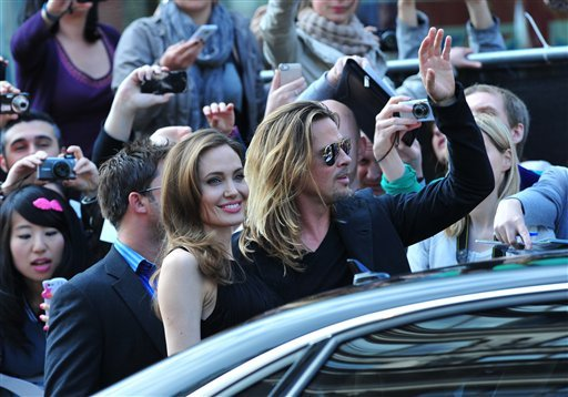 Angelina Jolie and Brad Pitt arrive at the World Premiere of 'World War Z' at the Empire Cinema in London on Sunday June 2nd, 2013. (Photo by Jon Furniss/Invision/AP Images)