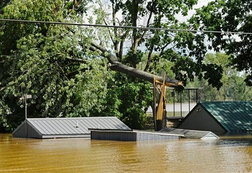 Homes and camps sit submerged up to their roofs along Engineers Road after being overtaken by the rain-swollen Osage River after it spilled its banks following Friday's heavy storms, Saturday, June 1, 2013 in Osage City, Mo.