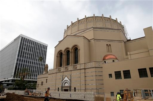 In this Wednesday, Jan. 23, 2013, photo, a construction worker walks past Wilshire Boulevard Temple in Los Angeles.