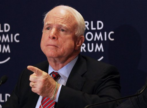 In this May 25, 2013 file photo, Sen. John McCain, R-Ariz. speaks at a news conference at the World Economic Forum, in Southern Shuneh, southeast of Amman, Jordan.