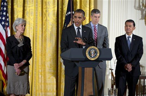 President Barack Obama, accompanied by, from left, Health and Human Services Secretary Kathleen Sebelius, Education Secretary Arne Duncan, and Veterans Affairs Secretary Eric Shinseki. (AP)