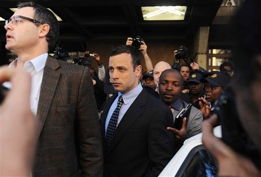 Oscar Pistorius, center, leaves the magistrates court in Pretoria, South Africa, Tuesday June 4, 2013.